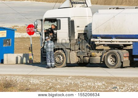 Taman, Russia - November 5, 2016: Verification Of Documents From The Driver Tank Truck At Security C