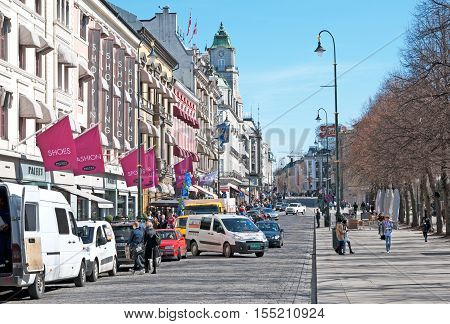 OSLO, NORWAY - APRIL 12, 2010: Street Karl Johans gate in the center of capital. It is a main street of the city