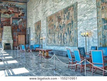 OSLO, NORWAY - APRIL 12, 2010: The City Hall Building interior. Fragment of The Gallery of Celebration with fresco by Axel Revold, tapestry by painter Kare Jonsborg, weaver Else Halling.