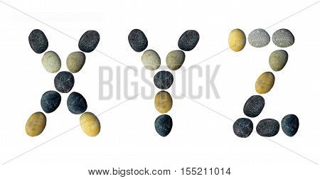 XYZ letters made of pebbles on a white background.
