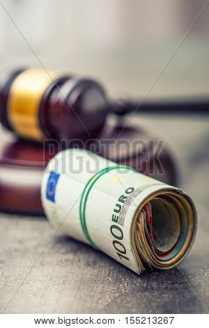 Judge's hammer gavel. Justice and euro money. Euro currency. Court gavel and rolled Euro banknotes. Representation of corruption and bribery in the judiciary.