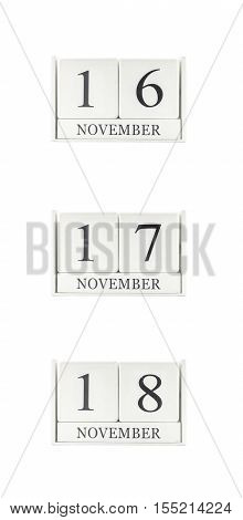 Closeup group of white wooden calendar with black 16 17 18 november word three date calendar isolated on white background