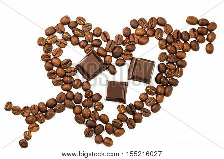 Roasted coffee beans in shape of heart with cupid arrow dark chocolate cubes isolated on white background top view