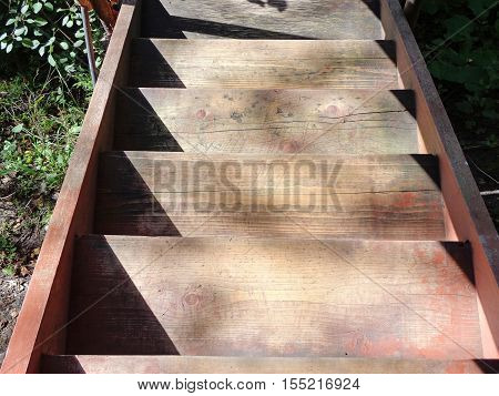 Steps of the wooden staircase of the village house