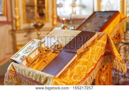 Golden religious utensils - Bible cross prayer book missal . Details in the Orthodox Christian Church. Russia.