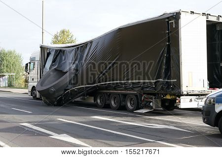 MAGDEBURG, GERMANY - NOVEMBER 01, 2016: Accident of a heavy load transporter in the inner city of Magdeburg. The charge slipped and fell on the road