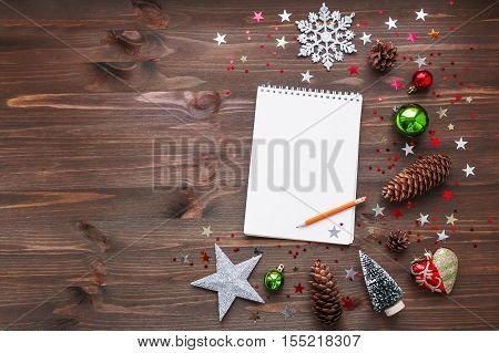 Christmas and New Year background with notepad pencil and decorations. To do list or list of promises place for your text. Mock up.