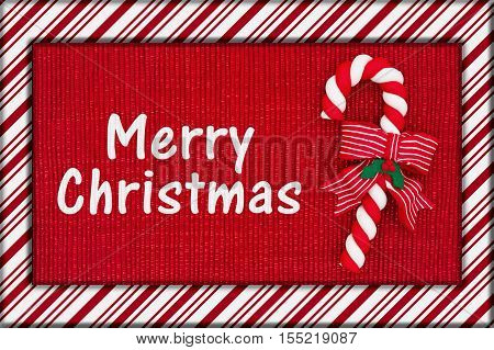 Merry Christmas Greeting Red shiny fabric with a candy cane and candy cane border with text Merry Christmas 3D Illustration