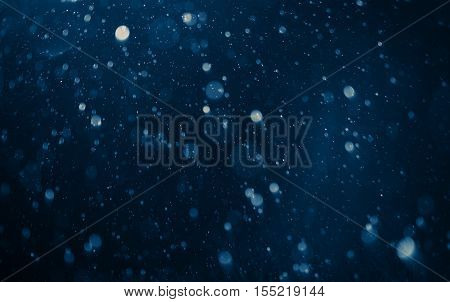 Night Time Rainfall. Real Photo of Falling Rain Drops Photo Background.