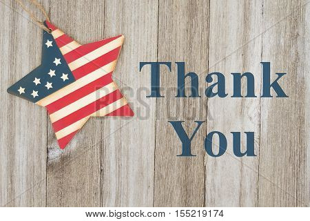 USA patriotic thank you message USA patriotic old flag on a star with weathered wood background with text Thank you for your service