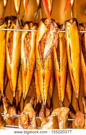 Closeup of smoked fresh fish in smokehouse