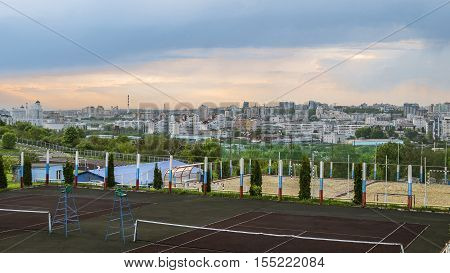 BELGOROD RUSSIA - MAY 08 2016: Evening view on the old center of city. by sports grounds of the Belgorod State Technological University. City skyline from the athletic fields of Belgorod State Technological University.
