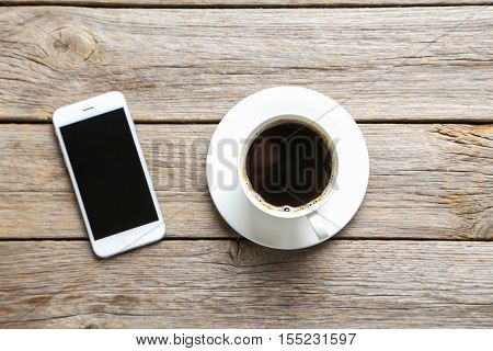 Cup Of Coffee And Smarphone On A Grey Wooden Table