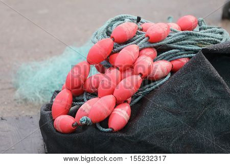Fishing net and red buoy in a basket