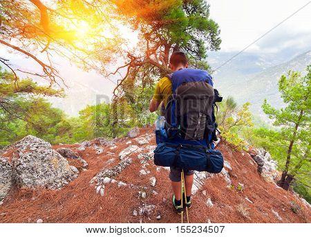 Man on Mountain Range at Sunrise. Antalya Province. Beautiful sunrise scenery in Turky, Asia