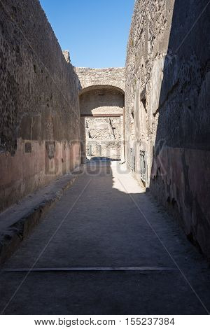 Narrow street in the ancient city of Pompeii destroyed during a catastrophic eruption of the volcano Mount Vesuvius in 79 AD