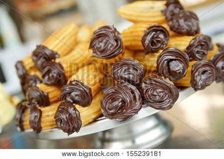 Group of typical churros at a stall, Spain.