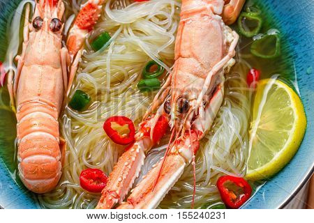 Closeup Of Traditional Thai Soup With Scampi