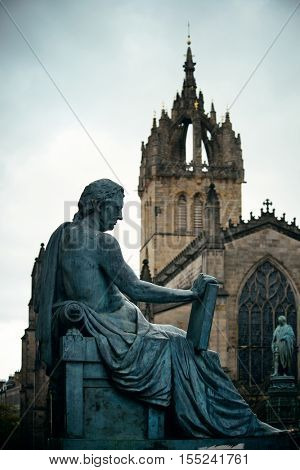 St Giles' Cathedral with David Hume statue as the famous landmark of Edinburgh. United Kingdom.
