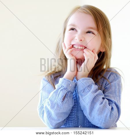Portrait Of A Cute Little Girl At Home
