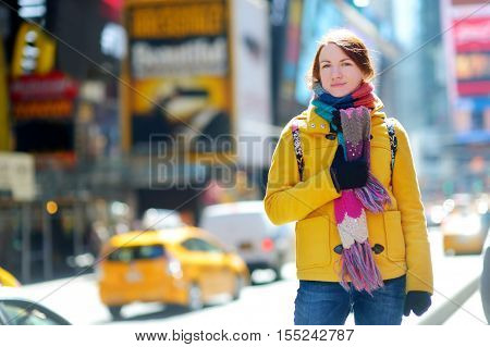 Beautiful Young Woman Sightseeing At Times Square, New York