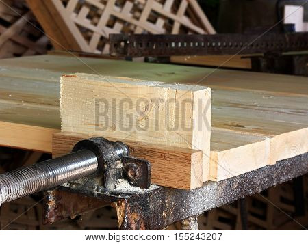 White wooden beam on the joinery machine for processing