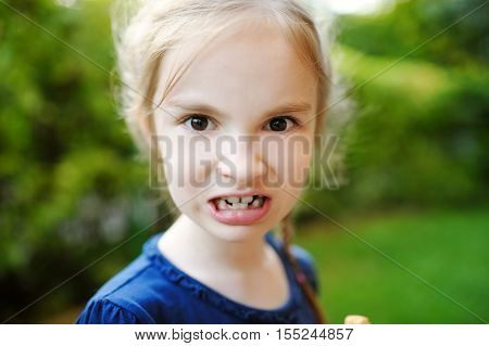 Adorable Little Girl Making Funny Faces On Beautiful Summer Day
