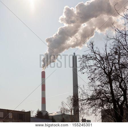 Dense smoke from chimney polluting air
