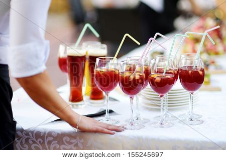 Waitress Holding A Dish Of Sangria Glasses At Some Festive Event