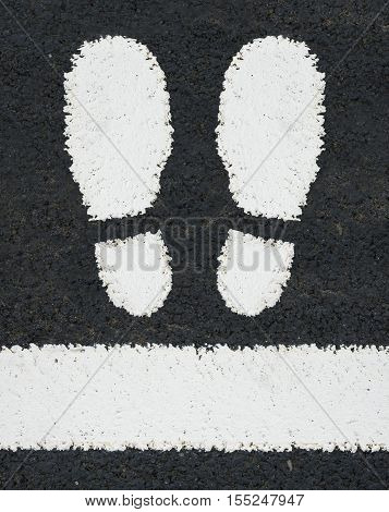 Symbol Of Two Feet Painted As A Road Marking