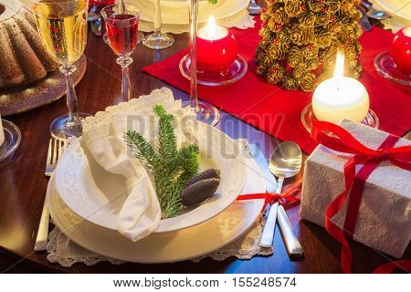 Free place at the Christmas table with candles