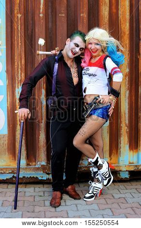 UKRAINE, ODESSA - August 13, 2016: Cosplayer girl in Harley Quinn costume and cosplayer men in Joker during Fan Expo Odessa, Comic Con