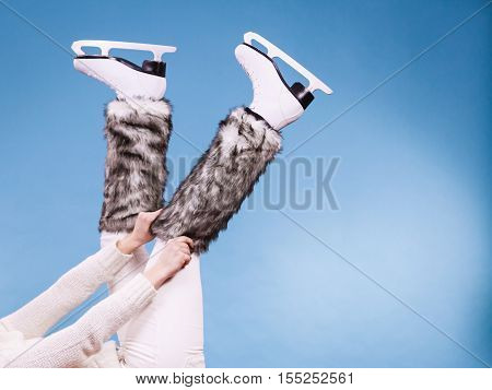 Woman Legs Wearing Ice Skates Fur Socks, Skating