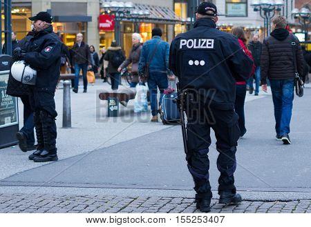Hamburg, Germany - November 04, 2016: Policemen on alert in Rathausmarkt, Hamburg,  Germany.