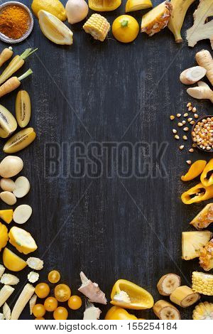 Book cover design with yellow hued fresh fruit and vegetables border frame layout in yellow colour spectrum