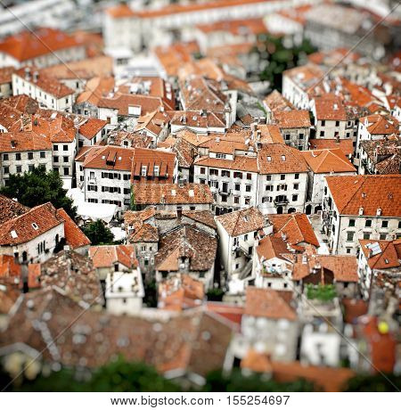 Aerial view of buildings in Kotor old town Montenegro. Tilt-shift Miniature Effect