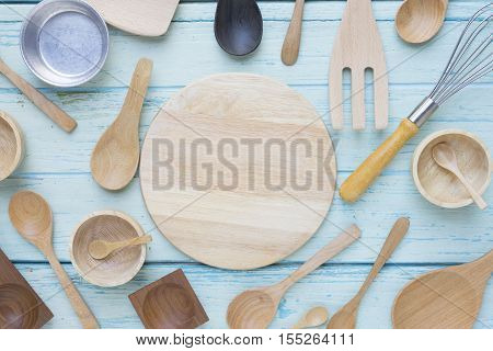 various kitchen utensils on wooden table background