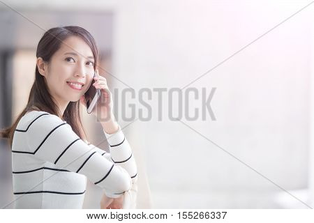 beauty woman talk on phone and look somewhere in hongkong