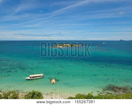 Island, tourist boat with clear seawater and blue sky background