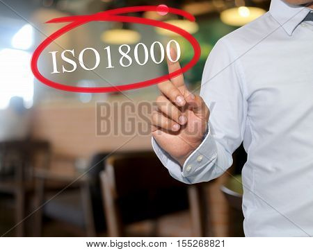 Hand of man touching text 18000 with white color on blur interior backgroundconcept of adoption to promote your business for organization.