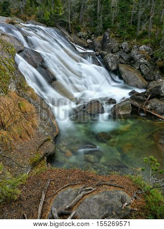 Waterfall rapids on a mountain stream. High Tatras mountains