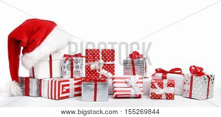 Christmas gift boxes with Santa Claus hat on white background