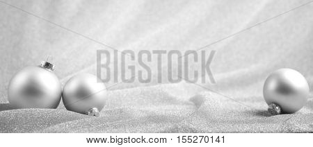 Silver Christmas balls on abstract background