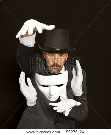 Magician in top hat showing trick. Magic, performance, circus, show concept