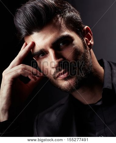 Closeup portrait of thinking young businessman.