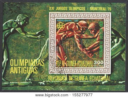 MOSCOW RUSSIA - OCTOBER 2016: a post stamp printed in EQUATORIAL GUINEA shows sportsmen circa 1974
