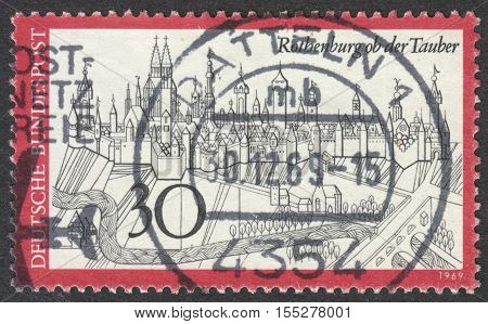 MOSCOW RUSSIA - CIRCA OCTOBER 2016: a post stamp printed in GERMANY shows View of Rothenburg ob der Tauber Germany circa 1969