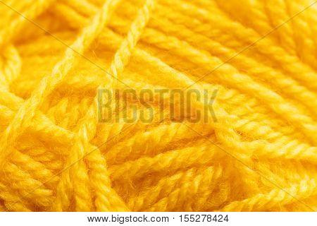 Yellow knitting thread texture, handiwork backdrop. Bright handiwork background, crochet woolen string, Leisure, hobby, needlework concept