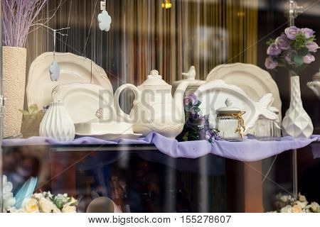 Shop window with different vintage kitchen dishes.