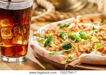 Fresh Pizza With Broccoli And Chicken Served With Cold Cola
